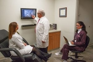 Doctor Explaining TV Content to Staff