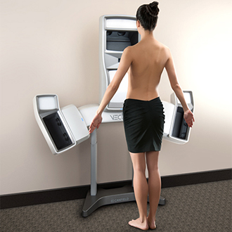 Woman standing in front of Vectra 3D machine